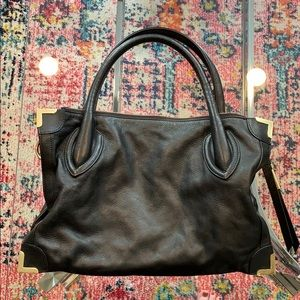 Foley + Corrina black and gold leather handbag